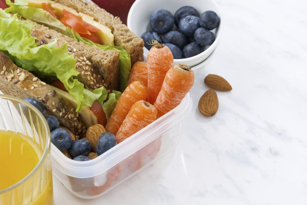 Sandwich with carrots, almonds and blueberries