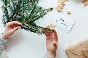 Woman wrapping gifts - 5 Ways To Manage Stress During the Holidays