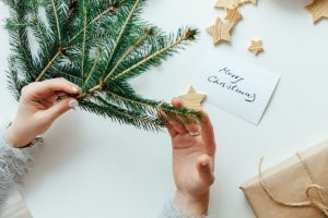 Woman packing Christmas gifts - 5 Ways To Manage Stress During the Holidays