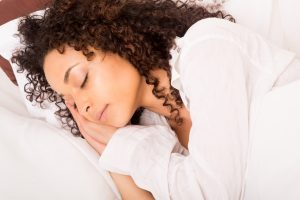 Woman sleeping -Ultimate Guide to Gut Health